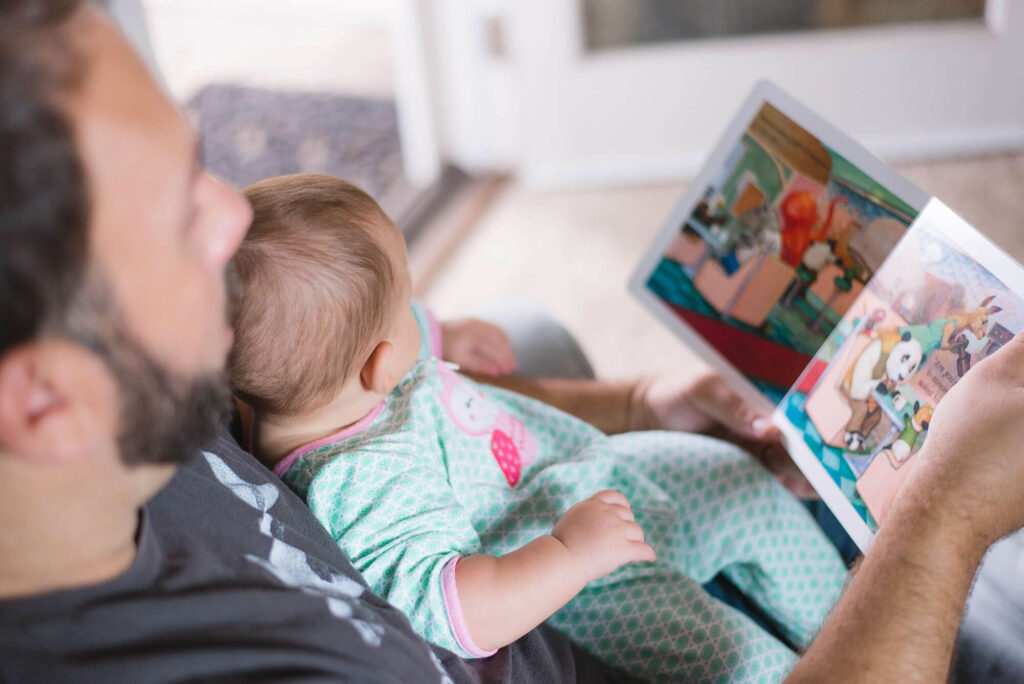 Father reading her child