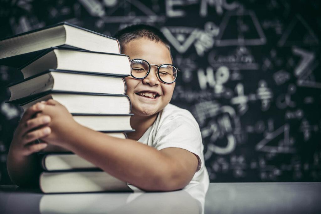 boy-hugging-pile-books